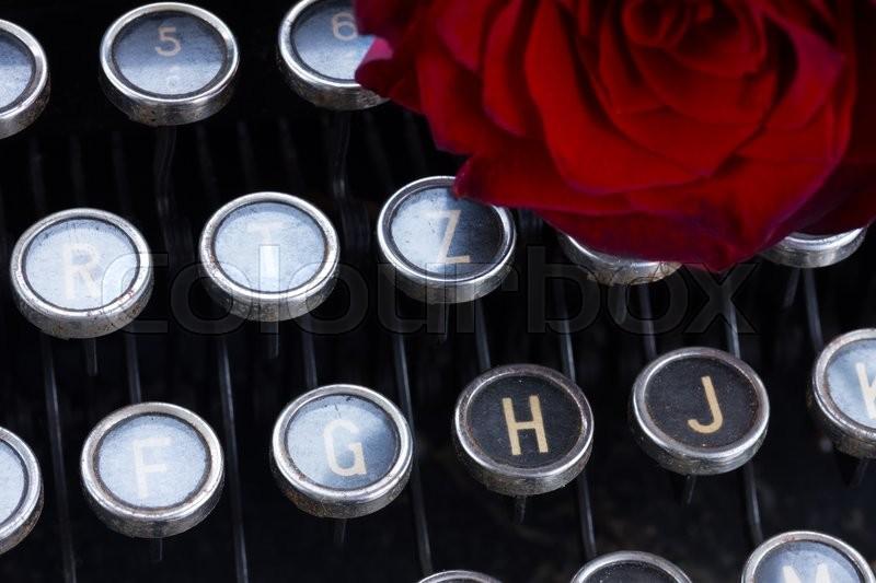 17315941-red-rose-on-typewriter-2